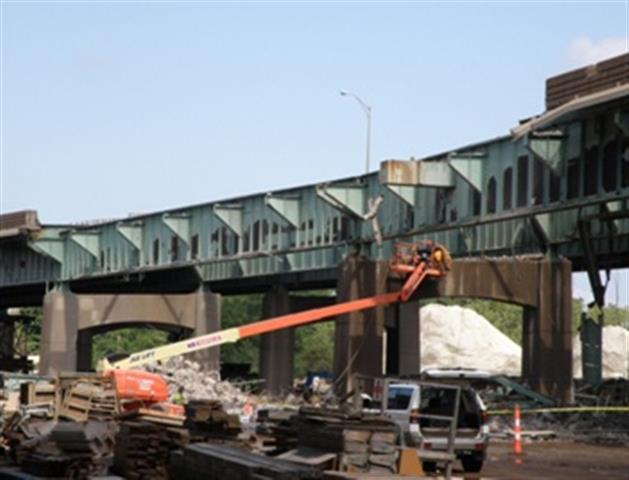 Partial demolition of original bridge in preparation for the construction of a temporary bridge to allow Southbound traffic onto the new Pearl Harbor Memorial (Q) Bridge