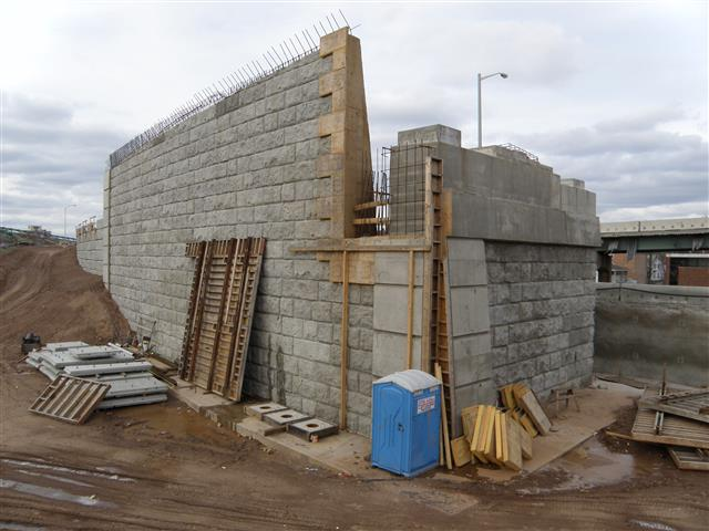 Bridge abutment and wing wall under construction to Route 34 Westbound ramp