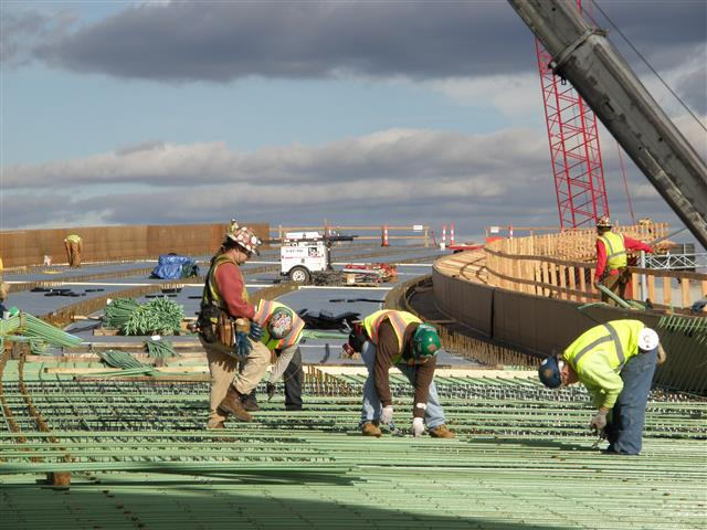 Iron workers installing reinforcement steel onto the I-95 Southbound bridge connector on the west approach of the new Q Bridge