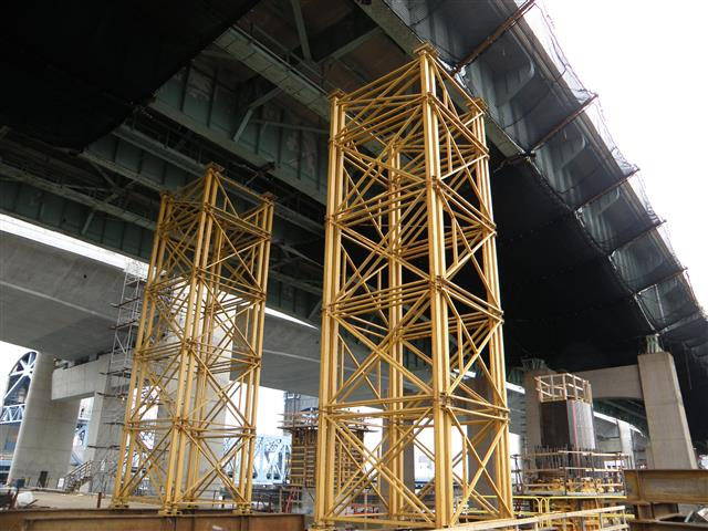 Temporary shoring towers to help support existing bridge structure during demolition