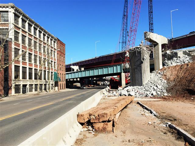 View of Water Street after removal of the old bridge adjacent to historic Cowles Building