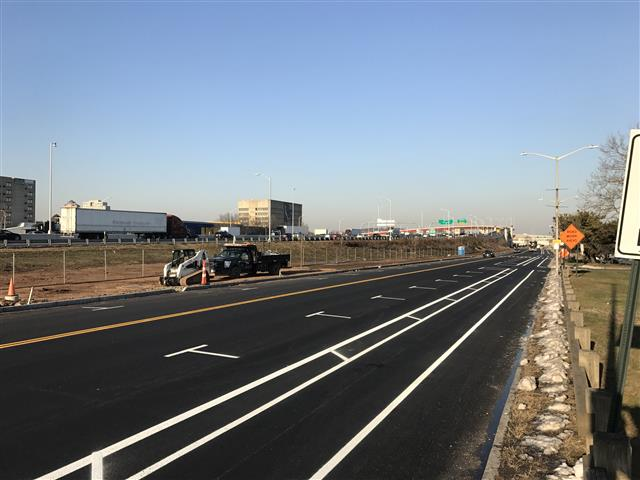 Completed paving operations and pavement markings for the I-95 NB off-ramp and on-ramp intersection at Long Wharf Drive
