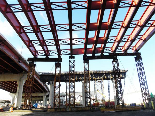 Structural steel with temporary shoring towers for the I-95 Southbound Pearl Harbor Memorial (Q) Bridge West Approach Structure